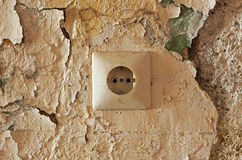 Old electrical outlet on decrepit wall Stock Photo
