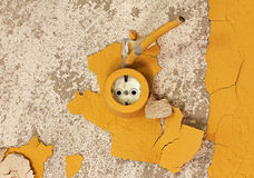 Old electrical outlet on the decrepit wall Stock Photography
