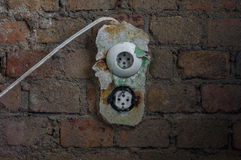 The old electrical outlet on decrepit wall, lost places Royalty Free Stock Photography