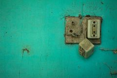 Old electrical outlet in disuse. Old wall stock photo