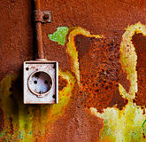 Old electrical outlet on rusty iron wall Stock Photo
