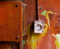 Old electrical outlet on the rusty iron wall Royalty Free Stock Image