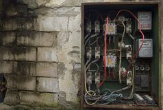 Old electrical panel. An old electrical panel on the side of a building royalty free stock images