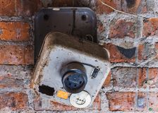 Old electrical panel on a brick wall.  royalty free stock photography