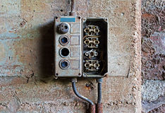 Old electrical panel on concrete wall. Old electrical panel on a concrete wall royalty free stock photos