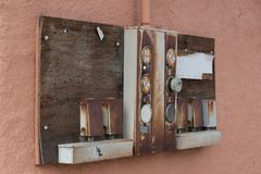 Old electrical panel mounted on a stucco wall of an old building. Old electrical panel with meters and breakers mounted on a stucco wall of an abandoned building stock photos