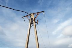 Old electrical pylon made of concrete and steeel. Electricity. stock image