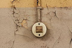 The Old electrical switch and cable on a decrepit wall Royalty Free Stock Photo