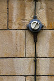 Old Electrical Switch ON OFF With Wires Stone Wall Background Stock Photo