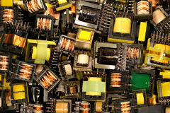 Old electrical transformers. Many old used electrical ferrite power transformers Royalty Free Stock Photos
