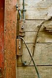 Old electrical wiring in a barn. Old electrical wiring is a fire hazard in an old barn building with carved initials in a support beam Royalty Free Stock Image