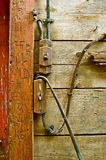Old Electrical Wiring System. Switches and wiring of an old barn flank the wood carvings etched into the door frame Royalty Free Stock Photos