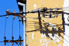 Old electricity cables and their shadow Royalty Free Stock Photography