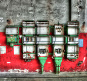 Old electricity cubicles. Electricity cubicles or boxes mounted on wall of old factory building Stock Photography