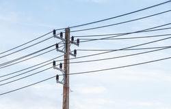 Old electricity post and blue sky. Royalty Free Stock Photo