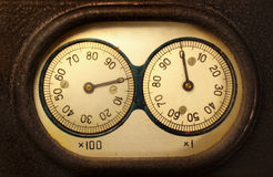 Old electromechanical counter - two dials and needles reading zeros Stock Image