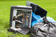 Old electronics on the grass Royalty Free Stock Photos
