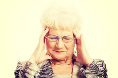 An old elegant lady is having a headache. Stock Photography