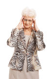 An old elegant lady is having a headache. Stock Images
