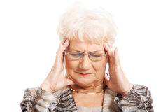 An old elegant lady is having a headache. Royalty Free Stock Photo