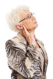 An old elegant lady touching her temple. Royalty Free Stock Photos