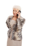 An old elegant lady using mobile phone. Stock Image