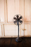The old eletric fan. The old electric fan standing in the old home royalty free stock photo