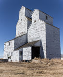 Old elevators. Old prairie grain elevators on a sunny afternoon Stock Photos
