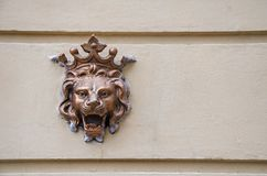 An old emblem on the wall. On the street Stock Photo