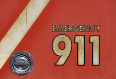 Emergency. Old emergency number on a fire engine Stock Image