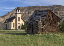 Old Emery Meeting House and settler cabin. An old abandoned Mormon Church and a cabin built by Mormon settlers in Emery Utah Royalty Free Stock Photography