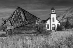 Old Emery Meeting House and settler cabin in Black and White Royalty Free Stock Images