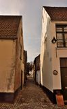 Old empty ancient cobbled streets and abbey houses Royalty Free Stock Images