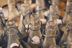 Old empty bottles closeup - bottlenecks of vintage soda bottles royalty free stock image