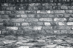 Old empty brick wall with stone floor. Royalty Free Stock Photos