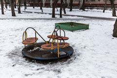 Old empty children playground in winter time.  Royalty Free Stock Image