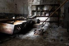 Old empty desolate dirty locksmith workshop Stock Photography
