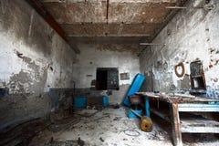 Old empty desolate dirty locksmith workshop Stock Photo