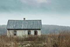 Old empty house on autumn field Royalty Free Stock Photo