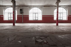 An old empty industrial warehouse interior Royalty Free Stock Photography
