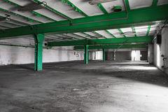 Old empty industrial warehouse interior, bright light Royalty Free Stock Image