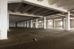 Old empty industrial warehouse interior, bright light Stock Images