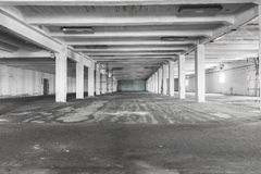 Old empty industrial warehouse interior, bright light Stock Image