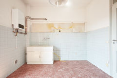 Old empty kitchen interior with tiled floor Royalty Free Stock Photo