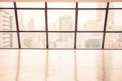 Old empty office space with large window Stock Photos