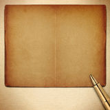 Old empty pages book with pen Royalty Free Stock Photos