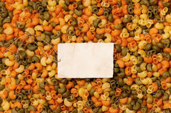 Old empty paper on raw pasta Royalty Free Stock Image