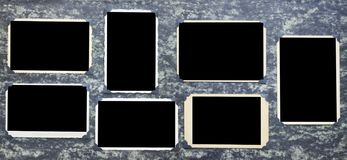 Old empty photo frames, vintage photographs on grungy background royalty free stock photography