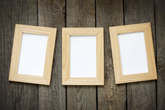 Old empty photos frame on vintage planks Stock Images