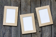 Old empty photos frame on vintage planks Royalty Free Stock Photo